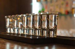 Row of glasses on a bar counter Royalty Free Stock Images