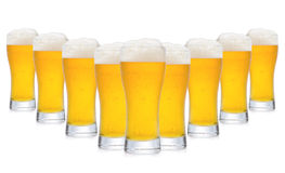 Row of glasses of beer Royalty Free Stock Images