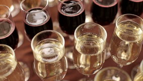 Row of glasses of champagne on table, close-up. stock video footage