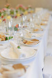 Row of Glasses and Plates Royalty Free Stock Image