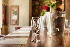 Row of glasses in a restaurant Royalty Free Stock Images