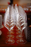 A row of glasses in a table Royalty Free Stock Image