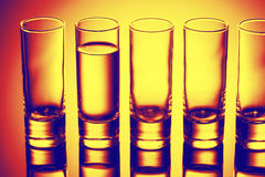 Row of glasses for vodka Royalty Free Stock Images