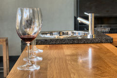 Row of glasses on wine-tasting table Stock Photo
