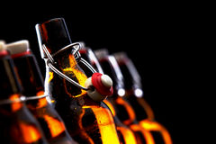 Row of glowing beer bottles with stoppers Royalty Free Stock Photo