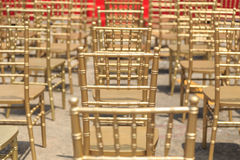 Row of gold color chair Royalty Free Stock Image