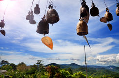 Row of golden bells in buddhist temple. Background of mountains in asia, tailandia Royalty Free Stock Image
