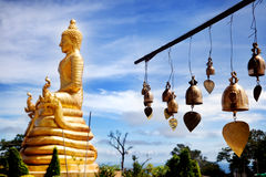 Row of golden bells in buddhist temple. big buddha in Thailand. Travel Royalty Free Stock Photos