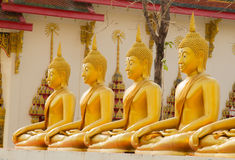 Row of Golden Buddha statue in Thailand Phichit, Thailand Royalty Free Stock Photography