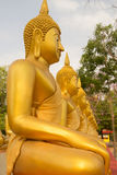 Row of Golden Buddha statue in Thailand Phichit, Thailand Royalty Free Stock Image