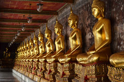 Row of golden Buddha in Thailand stock photography