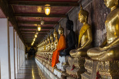 Row of Golden Buddha in Thailand. Bangkok, Thailand Royalty Free Stock Images
