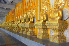 Row of golden Buddhas Royalty Free Stock Images