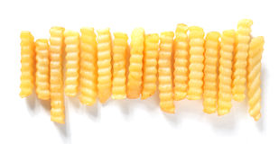 Row of golden friend crinkle cut potato chips Royalty Free Stock Photo