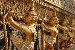 The row of golden Garuda. Golden Garuda sculpture in temple Stock Photos
