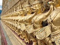 Row of golden garuda statues in temple, Bangkok, Thailand Royalty Free Stock Image