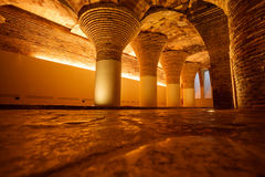 Row of golden illuminated ancient arched columns Stock Photos