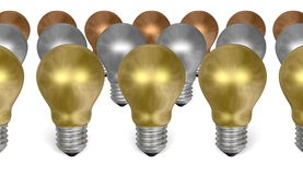 Row of golden light bulbs in front of silver and bronze ones Stock Photo