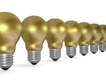 Row of golden light bulbs in perspective Royalty Free Stock Image
