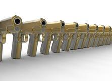 Row of golden pistols Stock Photo