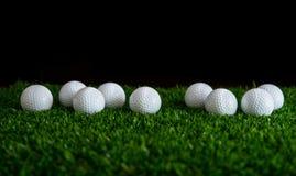 Golf ball on green grass. Row of golf ball on green grass  golf course Royalty Free Stock Photo