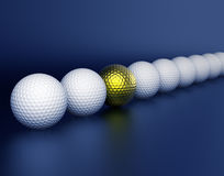 Row of Golf balls and golden ball in center Royalty Free Stock Image