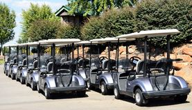Row of golf carts or buggies Royalty Free Stock Photography