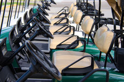 Row of golf carts closeup Royalty Free Stock Photo