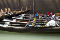 Row of gondolas parked around Piazza San Marco in Venice Royalty Free Stock Photography