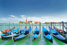 A row of gondolas parked beside the Riva degli Schiavoni. Venice Stock Images