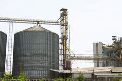 Row of granaries for storing wheat and other cereal grains, Agricultural Silo and  kept production from agriculture Stock Photos
