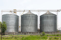 Row of granaries for storing wheat and other cereal grains, Agricultural Silo and  kept production from agriculture Royalty Free Stock Photos