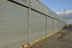 Row of gray closed containers. Under the open sky Stock Image