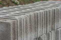 Row of gray concrete blocks on ground. Stock Images