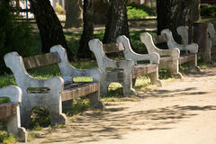 Row of gray stone benches Stock Image
