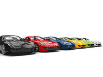 Row of great modern sports cars in various colors. Isolated on white background Stock Photos