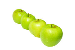 Row of green apples. Royalty Free Stock Images