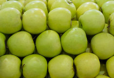 Row of green apples Stock Photos