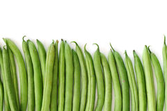 Row of green beans isolated on white Royalty Free Stock Images