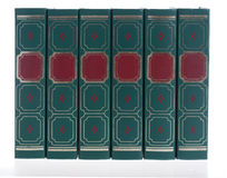 Row of green books. Row of six books, side by side - titles removed. Isolated on white with slight reflections on the bottom Stock Image