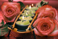 Row of green candles with roses Royalty Free Stock Photography