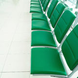 Row of green chairs Stock Images