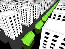 Row of green houses among many blocks of flats Stock Photo