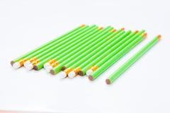 Row of Green Pencils on  white Royalty Free Stock Photos