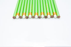 Row of Green Pencils on  white Royalty Free Stock Photography
