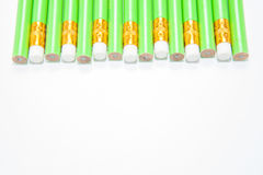 Row of Green Pencils on white Stock Images