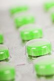 The row of green pills in a transparent package Stock Photo