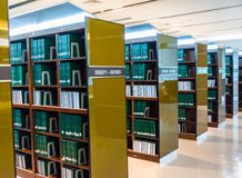 Row of green thesis in the large bookshelf in Chul Stock Photography