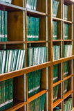 Row of green thesis in the large bookshelf in Chulalongkorn univ Stock Photos