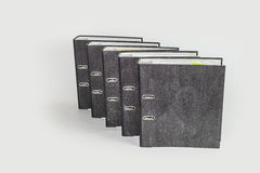 Row of grey files in front of white background Royalty Free Stock Photo